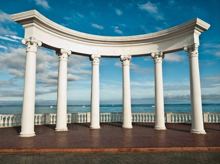 ancient greek: Ancient Greek columns against a blue sky and sea Stock Photo