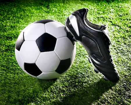 football shoes: soccer ball and shoes on a green lawn