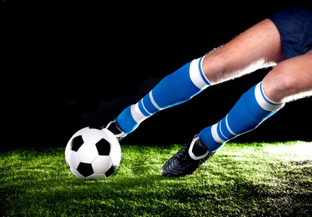 player hits the ball with his foot on the football field Stock Photo - 11010851