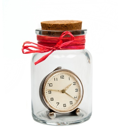 closed corks: old clock in bank with cork stopper Stock Photo