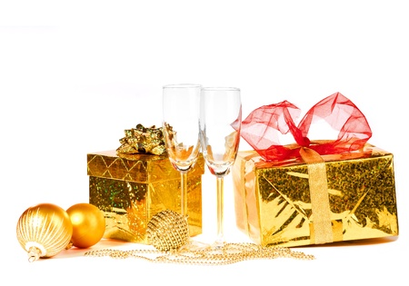 two glasses of champagne on a white background with a gift and decorations photo