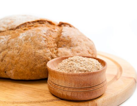 delicious bread isolated on a wooden board photo