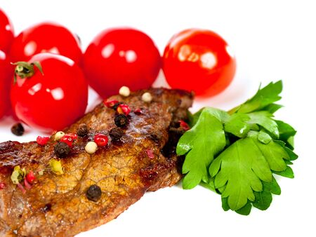 grilled steak with vegetables on a white photo