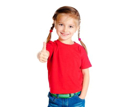 jolie petite fille: Positive girle peu montrant un pouce lev� contre le blanc Banque d'images