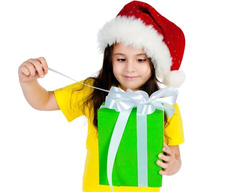 beautiful little girl with gifts in santa hat Stock Photo - 11354361