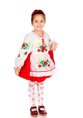 national costume: cute little girl dressed in traditional Ukrainian