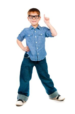 schoolboy raising his hand to give an answer - isolated on white photo
