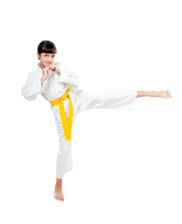 little girl in a kimono with a yellow sash on a white background Фото со стока