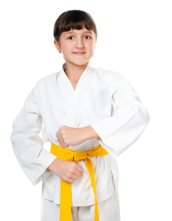 little girl in a kimono with a yellow sash on a white background photo
