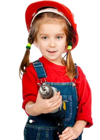 ittle: ittle girl in the construction helmet with a drill on a white background Stock Photo