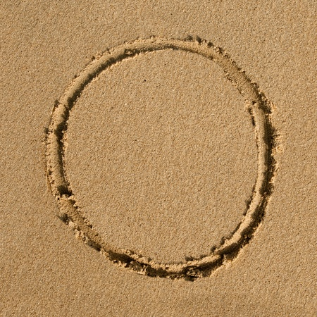 carved letters: English alphabet in the sand