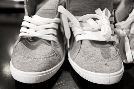 pair of sneakers in black and white tone photo