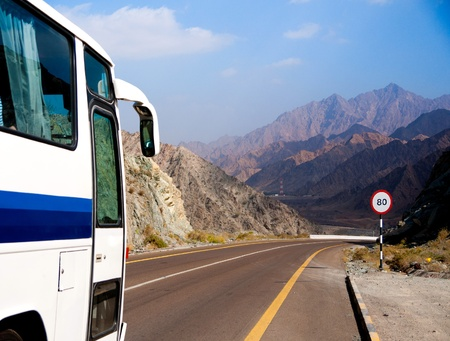 recreational vehicle: Bus rides on mountain road