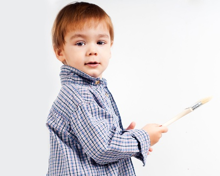 little boy with paintbrush on a light background Stock Photo - 12819770