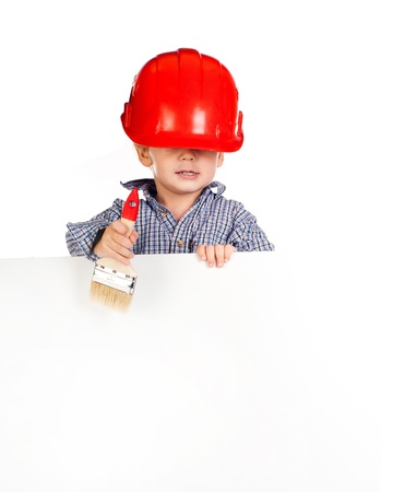 little boy with a brush in the helmet against white banner photo