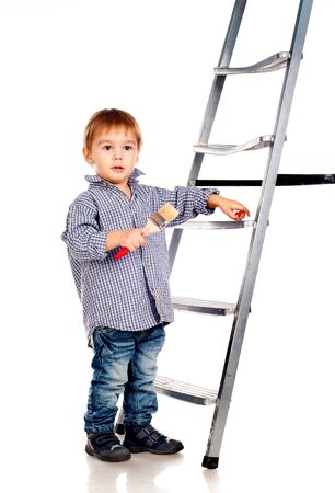 little boy with paintbrush and ladder photo