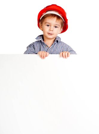 little boy wearing a helmet against white banner photo
