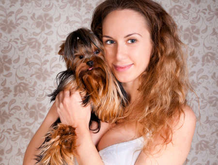 Beautiful girl with small cute york terrier dog photo