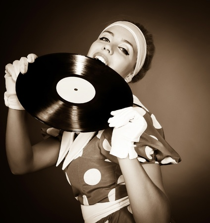 disks: Beautiful girl with a plate in a retro style