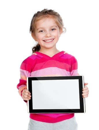 Pretty little girl with a Tablet PC photo