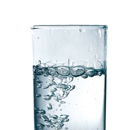 studio shot of pouring water in glass photo