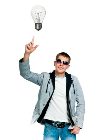 Portrait of a young man with light bulb above his head Stock Photo - 13189021