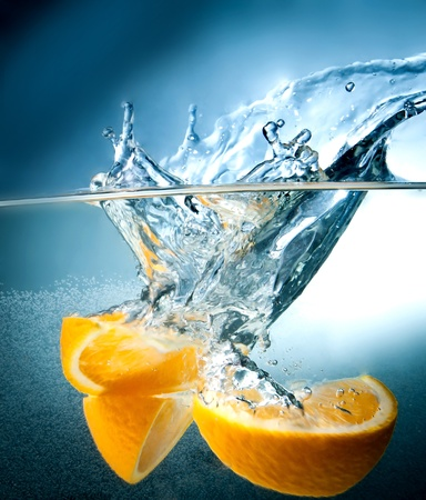 with lemon: citrus fruits fall into the water