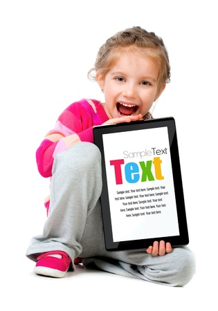 Pretty little girl with a Tablet PC Stock Photo - 13716604