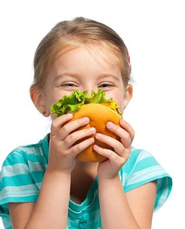 meisje eten: Mooi meisje eet een sandwich geïsoleerd op witte achtergrond
