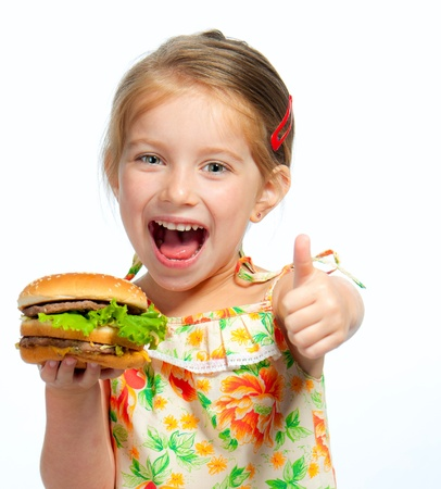 burger background: Pretty little girl eating a sandwich isolated on white background