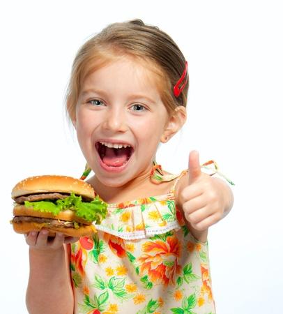 ni�a comiendo: Pretty ni�a comiendo un s�ndwich aislados sobre fondo blanco