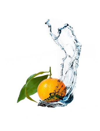 falling water: Fresh tangerines with water splash with leaves isolated on white background