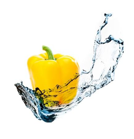 fresh taste: pepper with water splash isolated on white background Stock Photo