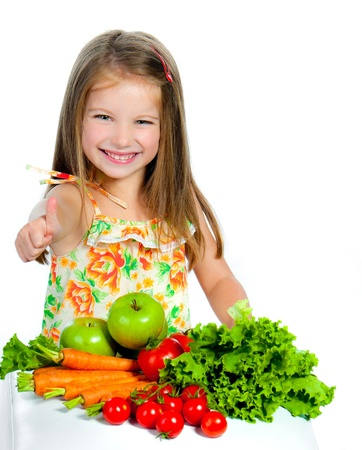 little sweet girl with vegetables, isolated on white background Stock Photo
