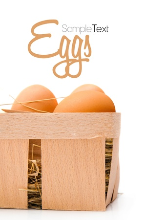 eggs in a wooden basket photo