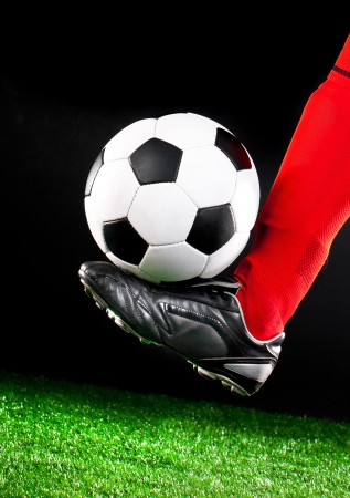 soccer ball and feet on the football field photo