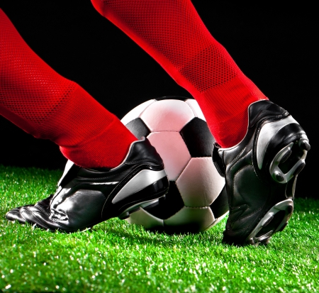 soccer boots: soccer ball and feet on the football field
