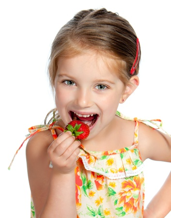 preschoolers: little cute girl holding a strawberry, isolated on white