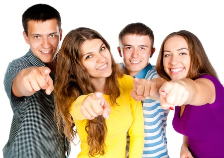 group of young people show forefingers into the camera photo