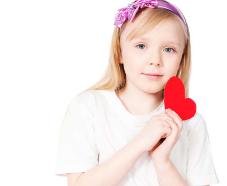 girl with red heart made   of paper on a white background photo