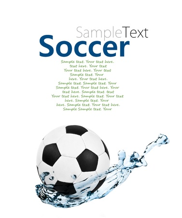 soccer ball in a water splash with sample text photo