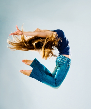 woman flying: Jumping Woman on a light background