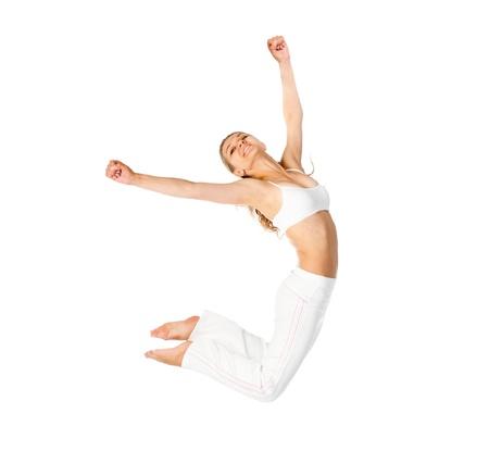 T�nzerIn: Jumping Frau auf einem hellen Hintergrund