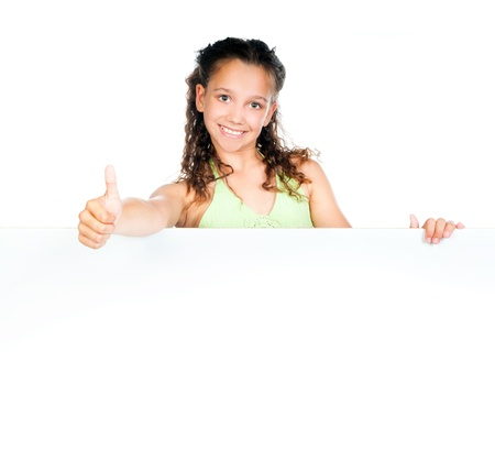 child holding sign: Beautiful little girl against a white blank