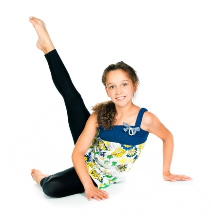 acrobat gymnast: girl gymnast on a white background
