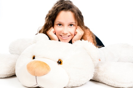 stuffed toy: Beautiful little girl with toy bear on a white background Stock Photo
