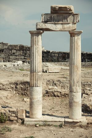 ruins of the ancient columns and arch photo