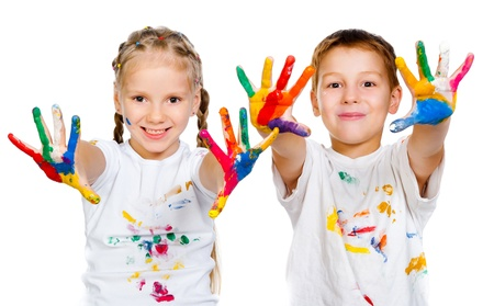 vibrant colors fun: kids with hands in paint  on a white background