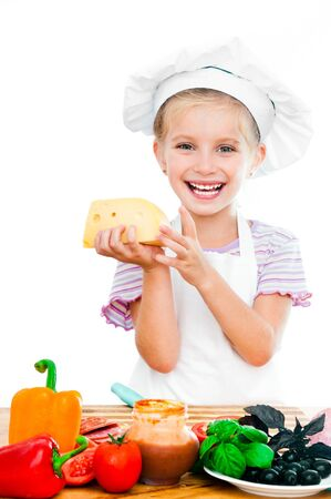 cute little girl little girl holding cheese on a white Stock Photo