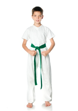 Young boy in kimono with green belt  on a white background photo